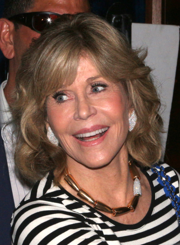 <p>Jane Fonda poses for photos on her way into the party.</p><br />(© David Gordon)