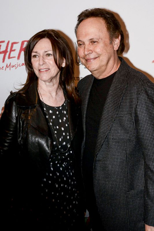 <p>Janice and Billy Crystal smile for the cameras on their way into New World Stages.</p><br />(© Nessie Nankivell)