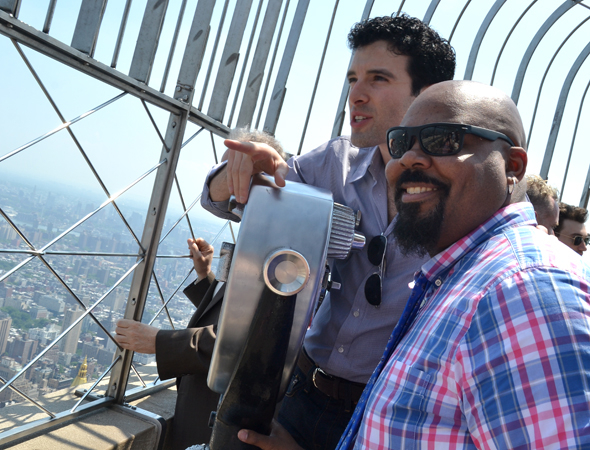 <p>Jarrod Spector and James Monroe Iglehart check out the East Side.</p><br />(© David Gordon)