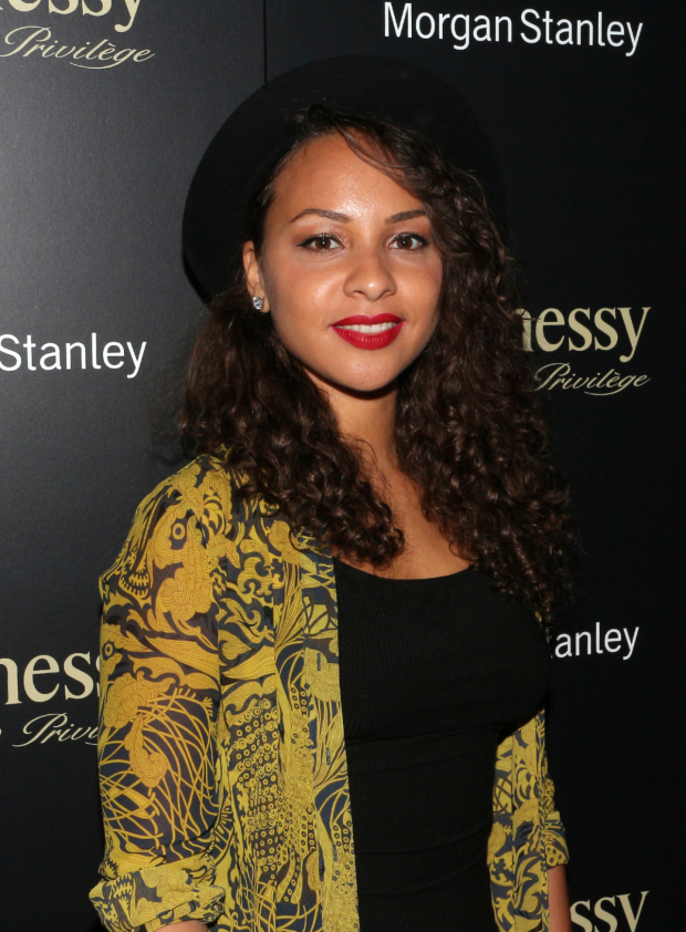 <p>Jasmine Cephas Jones poses for photos on her way into the party.</p><br />(© David Gordon)