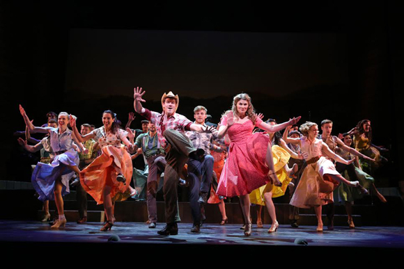 <p>Jay Armstrong Johnson and Heidi Blickenstaff lead the ensemble in a high-energy musical number.</p><br />(© Joan Marcus)