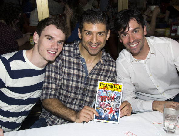 <p>Jay Armstrong Johnson, Tony Yazbeck, and Clyde Alves proudly show off a fully autographed <em>On the Town</em> program.</p><br />(© David Gordon)