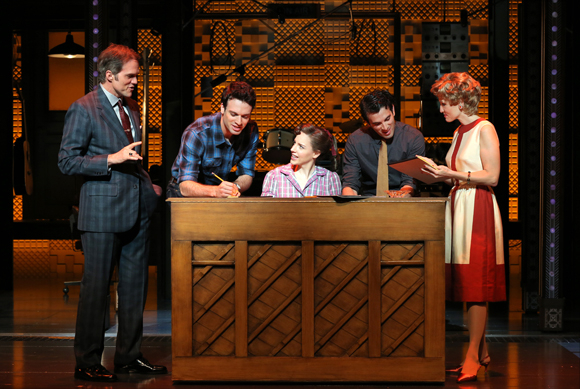 <p>Jeb Brown as Don Kirshner, Jake Epstein as Gerry Goffin, Jessie Mueller as Carole King, Jarrod Spector as Barry Mann, and Anika Larsen as Cynthia Weil gather around the piano.</p><br />(© Joan Marcus)
