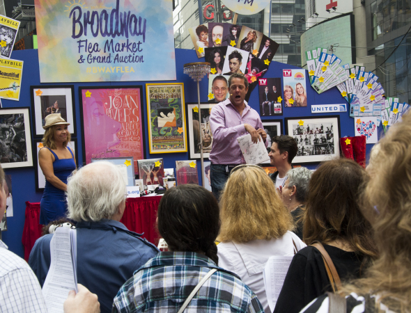 <p>Jen Cody and Michael Goddard oversee the silent auction.</p><br />(© David Gordon)