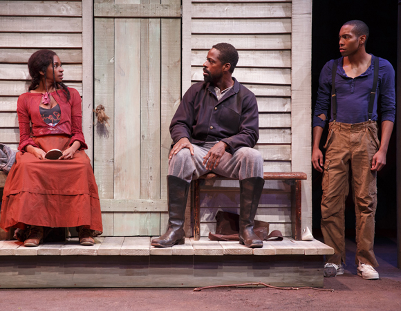 <p>Jeremie Harris (right) as Homer, a fellow slave, in a scene with Jenny Jules and Sterling K. Brown. </p><br />(© Joan Marcus)