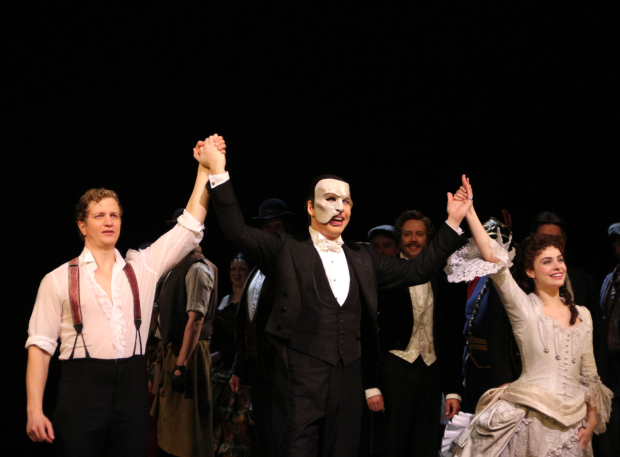 <p>Jeremy Hays, James Barbour, and Julia Udine take their bow on the 28th-anniversary performance of <em>The Phantom of the Opera</em>.</p><br />(© David Gordon)