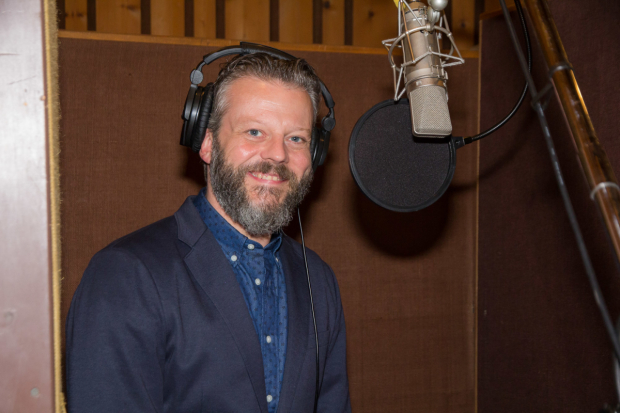 <p>Jeremy Kushnier smiles for the cameras in the recording studio.</p><br />(© Seth Walters)