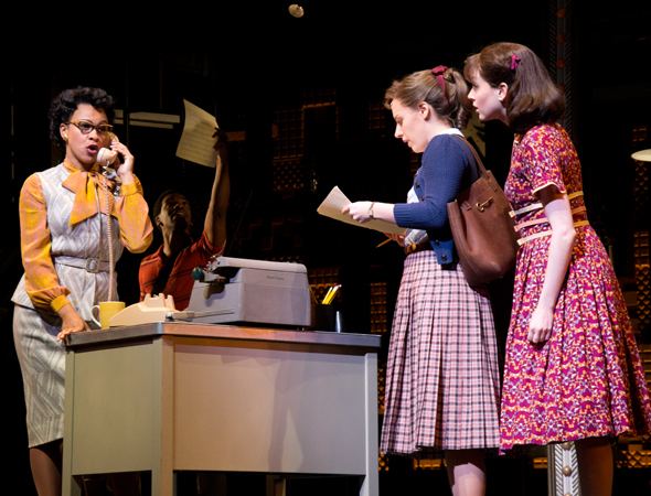 <p>Jessie Mueller (second from left), as Carole King, arrives at 1650 Broadway to sell a song.</p><br />(© David Gordon)