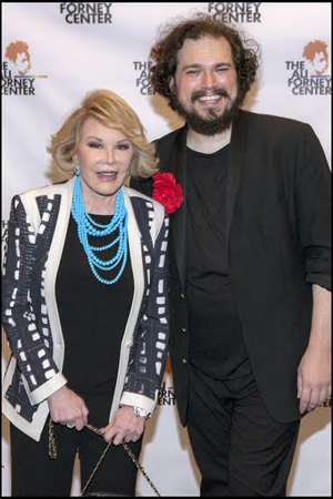 <p>Joan Rivers and Justin Sayre pose for photos on the red carpet.</p><br />(© Christopher Gagliardi)