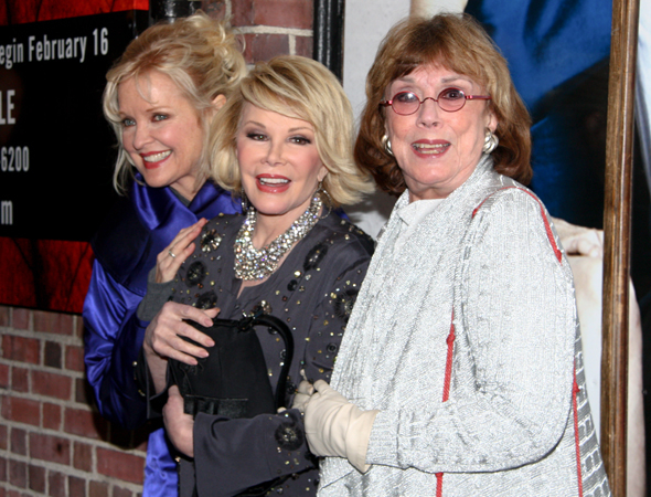 <p>Joan Rivers gets a hug from Christine Ebersole and Phyllis Newman at the opening of <em>Next Fall</em> in 2010.</p><br />(© Tristan Fuge)