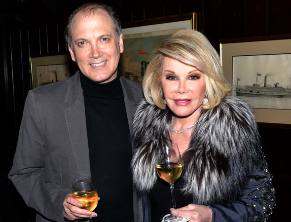 <p>Joan Rivers shares a glass of wine with Charles Busch at a party in 2011.</p><br />(© David Gordon)