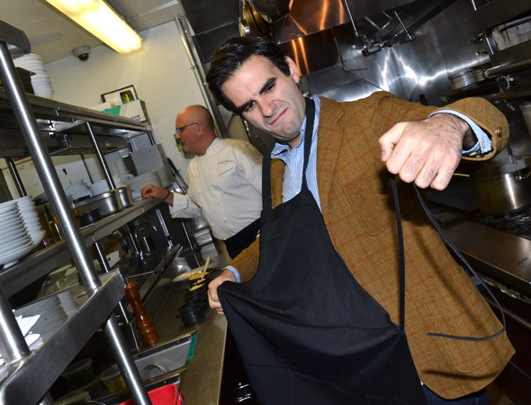 <p>Joe Iconis owns his manly apron.</p><br />(© David Gordon)