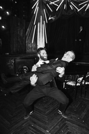 <p>Joel Grey is swept off his feet by <em>Queen of the Night</em> cast member Mason Ames.</p><br />(© Jenny Anderson)