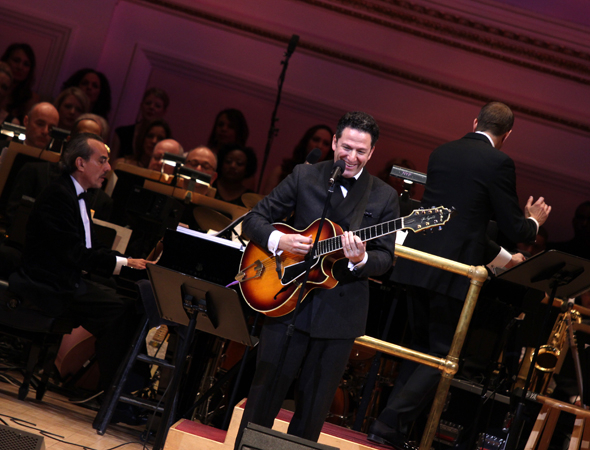 <p>John Pizzarelli accompanies himself on guitar while performing &quot&#x3B;A Wink and a Smile&quot&#x3B; from <em>Sleepless in Seattle</em>.</p><br />(© David Gordon)