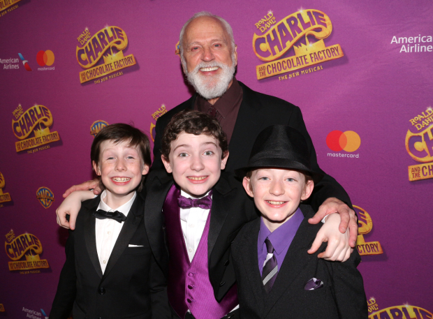 <p>John Rubinstein, who plays Grandpa Joe, takes a photo with the three young men who play Charlie: Jake Ryan Flynn, Ryan Sell, and Ryan Foust.</p><br />(© David Gordon)