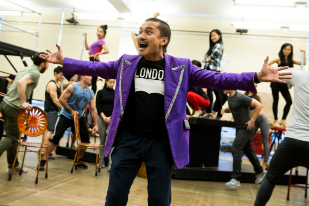 <p>Jon Jon Briones takes center stage during a big number.</p><br />(© Matthew Murphy)
