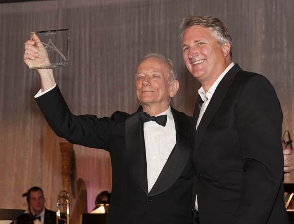 <p>Jonathan Tunick accepts the Stephen Sondheim Award from Signature Theatre Artistic Director Eric Schaeffer.</p><br />(© Margot Schulman)