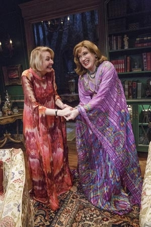 <p>Julie Halston and Charles Busch clasp hands in the Primary Stages production of <em>The Tribute Artist</em>.</p><br />(© James Leynse)