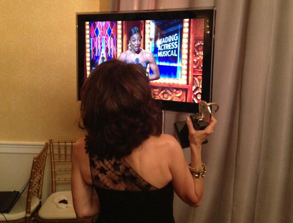 <p>June 9: Andrea Martin clutches her 2013 Tony Award and watches from the press room as her <em>Pippin</em> costar, Patina Miller, accepts her own Tony a few minutes later.</p><br />(© David Gordon)