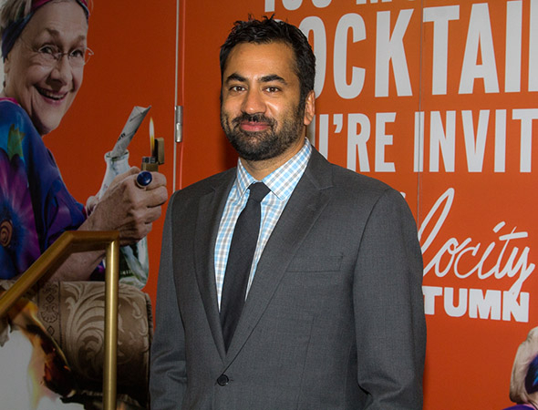 <p>Kal Penn poses for photos on his way into the Booth Theatre.</p><br />(© Seth Walters)