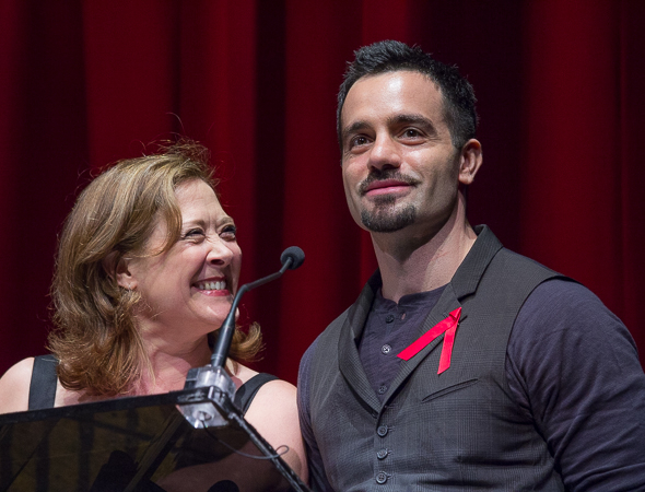 <p>Karen Ziemba and Ramin Karimloo introduce the next act.</p><br />(© David Gordon)