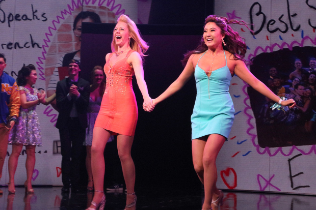 <p>Kate Rockwell and Ashley Park run out for their curtain calls.</p><br />(© David Gordon)