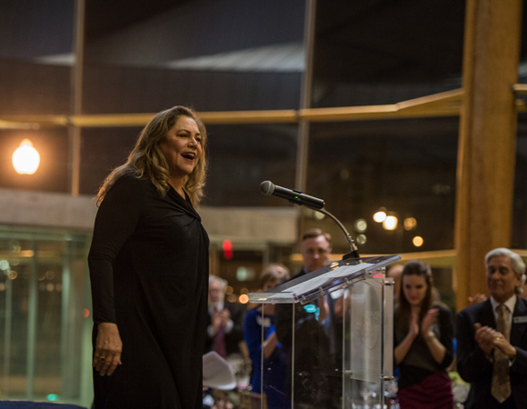 <p>Kathleen Turner, soon to star in the Arena Stage production of <em>Mother Courage and Her Children</em>, accepts the American Artist Award at the opening night celebration for <em>The Tallest Tree in the Forest</em>.</p><br />(© Cameron Whitman Photography)