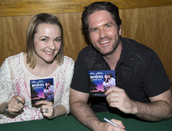 <p>Katie Klaus and Aaron Ramey are ready to sign some CDs.</p><br />(© David Gordon)