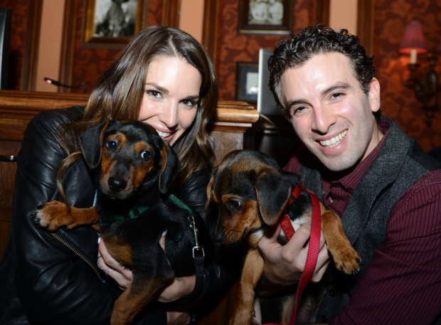 <p>Kelli Barrett and Jarrod Spector show off Simon and Sebastian, two beautiful puppies who are available for adoption from the Humane Society of New York.</p><br />(© Allison Stock)