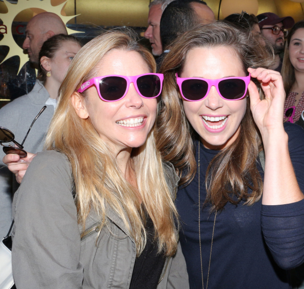 <p>Kerry Butler and Erika Henningsen try on <em>Mean Girls</em> sun glasses.</p><br />(© David Gordon)