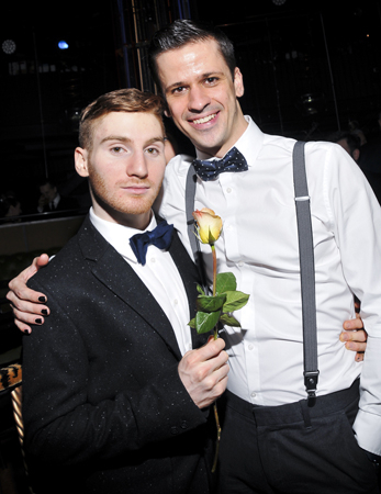 <p>Kevin Beverley and Olaf Triebel pose with a rose on opening night.</p><br />(© Jenny Anderson)
