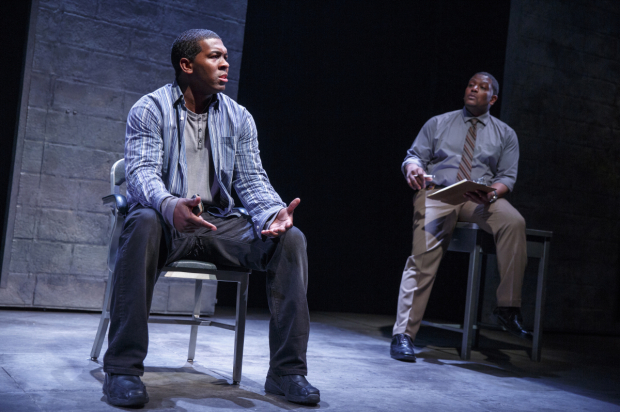 <p>Khris Davis and Lance Coadie Williams share a scene, bathed in blue.</p><br />(© Joan Marcus)