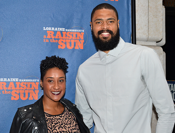<p>Kimberly and Tyson Chandler are ready to see Denzel and company in action.</p><br />(© David Gordon)