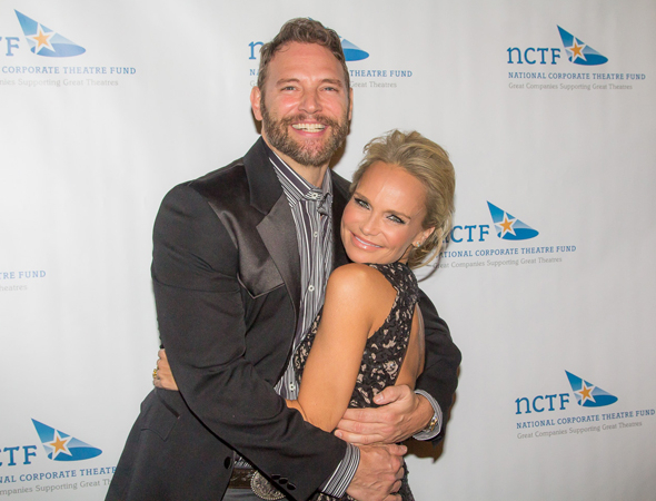 <p>Kristin Chenoweth shares a big hug with fellow theater actor Jim Newman.</p><br />(© Seth Walters)