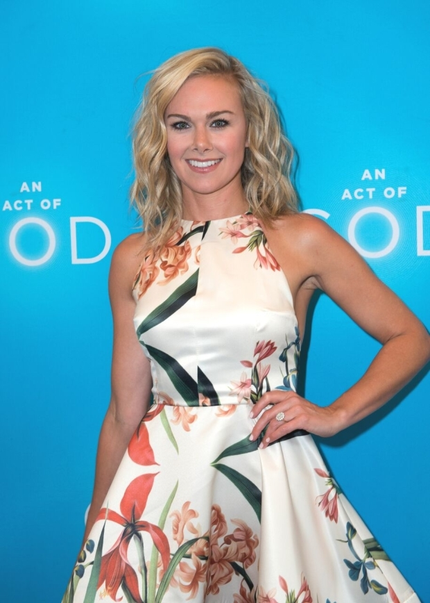 <p>Laura Bell Bundy smiles for the cameras.</p><br />(© Allison Stock)