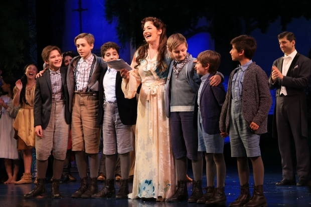 <p>Laura Michelle Kelly gathers close to her stage sons.</p><br />(© Tricia Baron)
