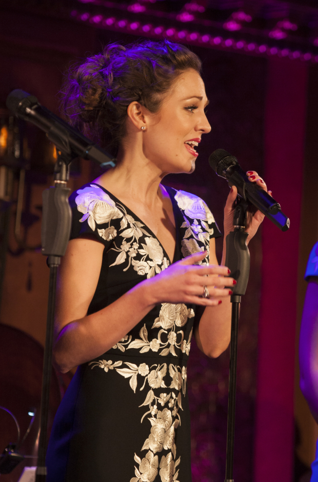 <p>Laura Osnes took to the mic.</p>