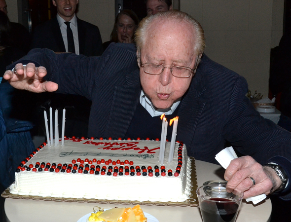 <p>Legendary musical coordinator Seymour Red Press, celebrating his 90th birthday, blows out the candles on his cake.</p><br />(© David Gordon)