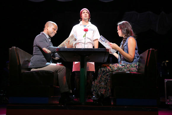 <p>Leslie Odom Jr. and Karen Olivo join Lin-Manuel Miranda at his character Jon&#39&#x3B;s job in a diner.</p><br />(© Joan Marcus)