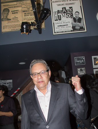 <p>Lewis Black points at a poster for his show at Cherry Lane from years past.</p><br />(© Seth Walters)