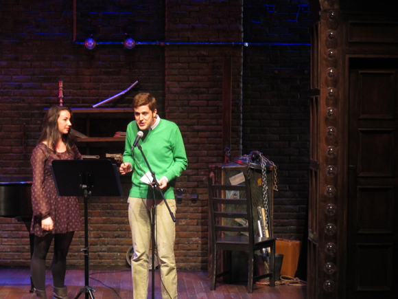 <p>Lucy Braid joins Blair on the <em>Murder for Two</em> stage.</p><br />(© Colgan McNeil)