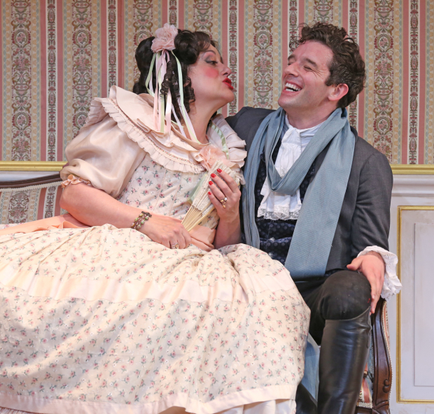 <p>Mary Testa cuddles close to Michael Urie.</p><br />(© Carol Rosegg)
