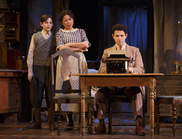<p>Matthew Schechter and Mimi Lieber look on as Santino Fontana (as Moss Hart) sits at his typewriter.</p><br />(© Joan Marcus)