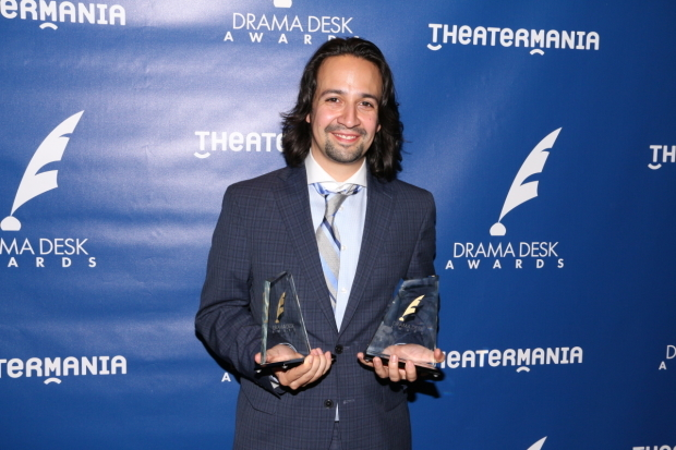 <p>May 31, 2015: Miranda shows off two of his three newly won Drama Desk Awards, for Outstanding Music, Outstanding Lyrics, and Outstanding Book of a Musical. </p><br />(© David Gordon)