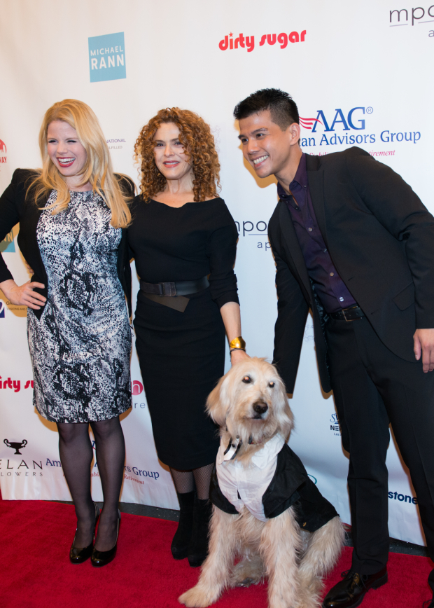 <p>Megan Hilty, Bernadette Peters, and Telly Leung join a dog in a tux on the red carpet.</p><br />(© Allison Stock)