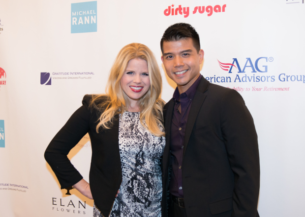<p>Megan Hilty smiles for the cameras alongside Telly Leung.</p><br />(© Allison Stock)