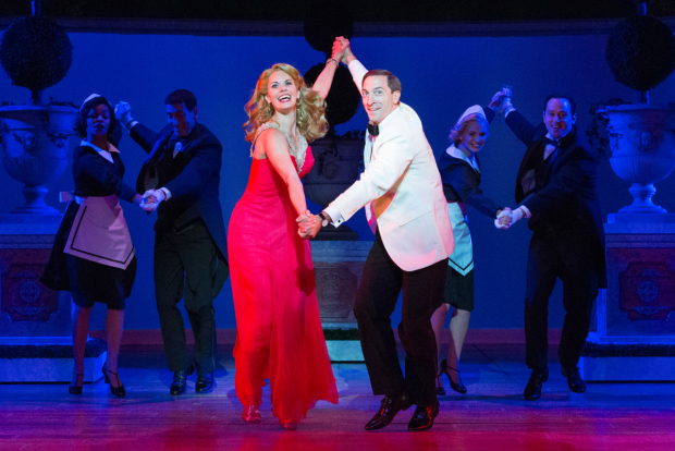 <p>Megan Nicole Arnoldy as Tracy Lord, Ben Dibble as Macaulay &quot&#x3B;Mike&quot&#x3B; Connor, and the ensemble in Walnut Street Theatre's production of <em>High Society</em>.</p><br />(© Mark Garvin)