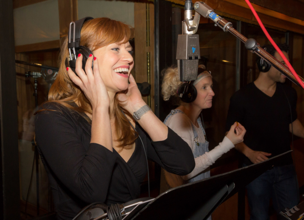 <p>Megan Sikora enjoys a moment behind the mic.</p><br />(© Seth Walters)