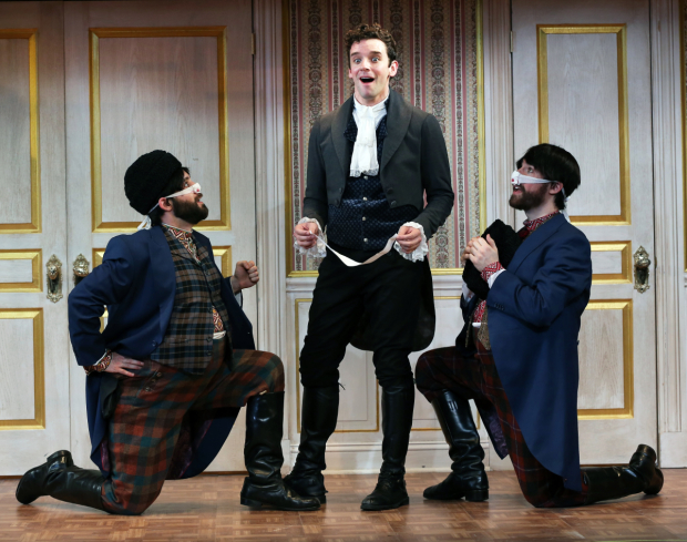 <p>Michael Urie (center) stars as Hlestakov.</p><br />(© Carol Rosegg)