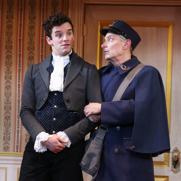 <p>Michael Urie stands arm in arm with Arnie Burton. </p><br />(© Carol Rosegg)